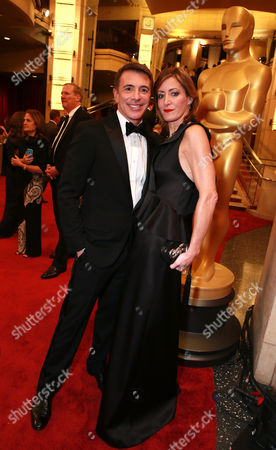 President, Marketing, The Walt Disney Studios Ricky Strauss and Cindy Capobianco, Founder/President of Capobianco & Associates PR Agency arrive at the Oscars, at the Dolby Theatre in Los Angeles