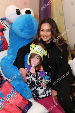 Bianca Wakelin, left, and actress Tia Carrere is seen at the American Music Awards KIIS FM Wonka NERDS Gifting Suite, on Saturday, November, 23, 2013 in Los Angeles