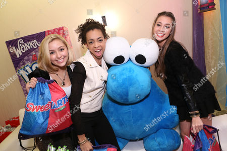Singers Millie Thrasher, Summer Reign, Celine Polenghi of Sweet Suspense are seen at the American Music Awards KIIS FM Wonka NERDS Gifting Suite, on in Los Angeles