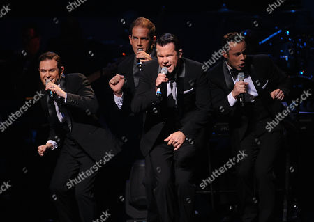 Stock Picture of Andrew Tierney, Michael Tierney, Phil Burton and Toby Allen of the music group Human Nature perform on stage at the Apollo Theater Spring Gala and 80th Anniversary Celebration at the Apollo Theater on Monday, June, 10, 2014 in New York City