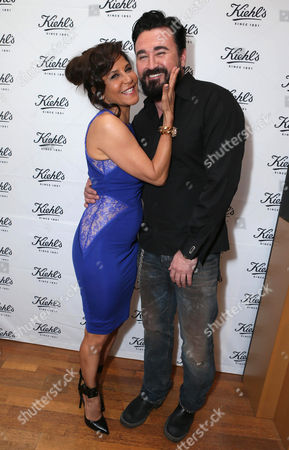 Laurie Lynn Stark, left, and president of Kiehl's Chris Salgardo arrive at Kiehl's Earth Day party hosted by Ashley Judd & Anthony Mackie on in Santa Monica, Calif