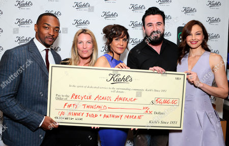 From left, Anthony Mackie, executive director of Recycle Across America Mitch Hedlund, Laurie Lynn Stark, president of Kiehl's Chris Salgardo, and Ashley Judd are seen at Ashley Judd & Anthony Mackie host Earth Day party at Kiehl's on in Santa Monica, Calif