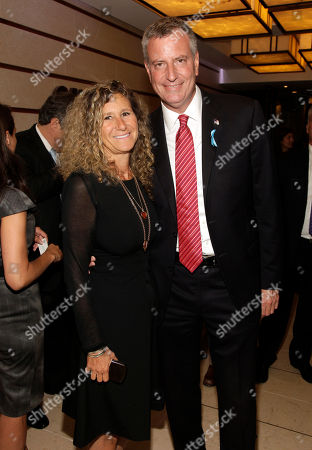 Edie Lutnick, Co-Founder and Executive Director of The Cantor Fitzgerald Relief Fund, left, and Mayor of New York Bill de Blasio, right, attend Cantor Fitzgerald and BGC Partners' 10th Annual Charity Day on in New York