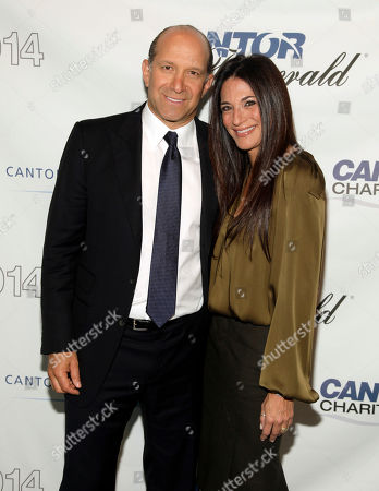 Howard Lutnick, Chairman and CEO of Cantor Fitzgerald, left, and Allison Lambert, right, attend Cantor Fitzgerald and BGC Partners' 10th Annual Charity Day on in New York