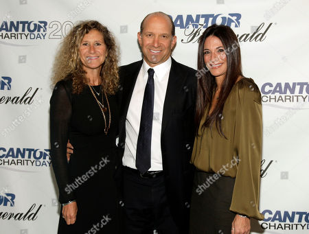 Edie Lutnick, from left, Co-Founder and Executive Director of The Cantor Fitzgerald Relief Fund, Howard Lutnick, Chairman and CEO of Cantor Fitzgerald, and Allison Lambert attend Cantor Fitzgerald and BGC Partners' 10th Annual Charity Day on in New York