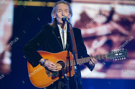 Singer Gordon Lightfoot performs during the CFL's 100th Grey Cup Championship Halftime Show at the Rogers Centre, in Toronto