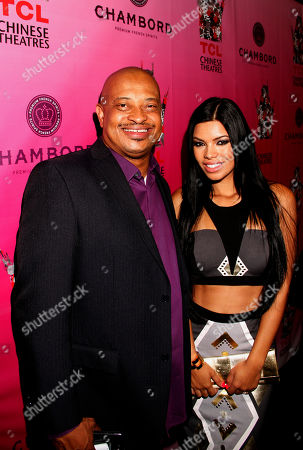 Derrell Spann and model Suelyn Medeiros arrive at Chambored Vodka Goes Hollywood Hosted by Boris Kodjoe at Chinese 6 Theatre Ballroom in Hollywood, Calif