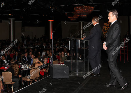 Jeremy Zimmer, CEO and co-founder of UTA, left, and Bryan Cranston speak onstage at the CoachArt Gala of Champions in Beverly Hills, Calif. on