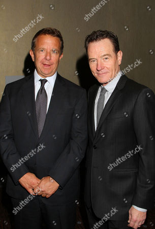 Jeremy Zimmer, CEO and co-founder of UTA, left, and Bryan Cranston attend the CoachArt Gala of Champions in Beverly Hills, Calif. on