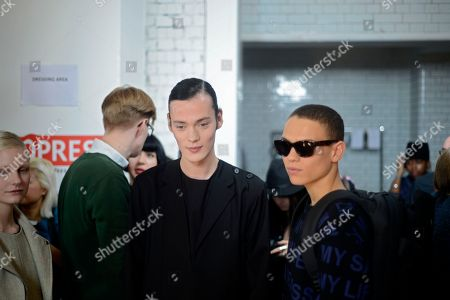 Stock Image of Models Chris Arundel and Joel Mignott, wear designs from the Matthew Miller collection backstage during London Collections: Men AW14, in London