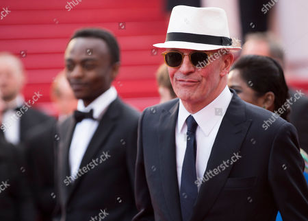 Marc Zinga and director Jacques Audiard arrive for the screening of the film Dheepan at the 68th international film festival, Cannes, southern France