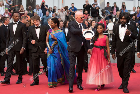 From left, Marc Zinga, Vincent Rottiers, Kalieaswari Srinivasan, director Jacques Audiard, Claudine Vinasithamby and Jesuthasan Antonythasan arrive for the screening of the film Dheepan at the 68th international film festival, Cannes, southern France