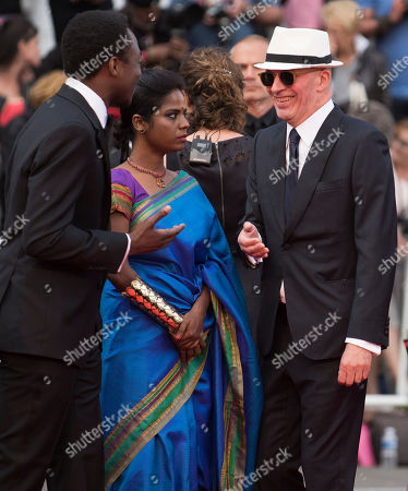 Marc Zinga, Kalieaswari Srinivasan and director Jacques Audiard arrive for the screening of the film Dheepan at the 68th international film festival, Cannes, southern France