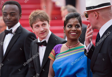 From left, Marc Zinga, Vincent Rottiers, Kalieaswari Srinivasan and director Jacques Audiard arrive for the screening of the film Dheepan at the 68th international film festival, Cannes, southern France