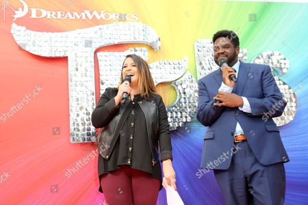 "Red Carpet Emcee Sisanie Villa Clara and Ron Funches seen at DreamWorks Animation and Twentieth Century Fox Present the Los Angeles Premiere of ""Trolls"" at Regency Village Theatre, in Los Angeles"