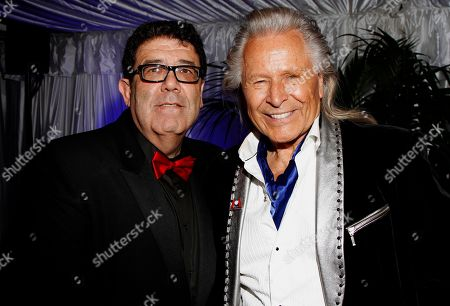 Stock Image of Victorino Noval and Peter Nygard seen at Fame and Philanthropy's Celebrates the 86th Academy Awards on at The Vineyard Beverly Hills in Los Angeles, CA