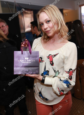 Actress Alexandra Holden visits the Urban Decay make-up station at the Fender Music lodge during the Sundance Film Festival, in Park City, Utah