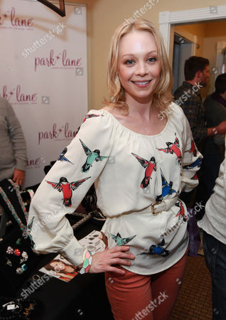 Actress Alexandra Holden visits the Park Lane jewelry booth at the Fender Music lodge during the Sundance Film Festival, in Park City, Utah