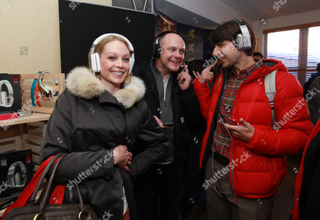 From left, actors Alexandra Holden, Demetri Martin and Rob Corddry wear Inspriation headphones by Monster Products at the Fender Music lodge during the Sundance Film Festival, in Park City, Utah