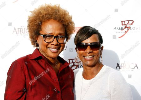"""Actress Vanessa Bell Calloway (L) seen with Paula Williams Madison who hosted industry friends at screening of her autobiographical documentary, """"Finding Samuel Lowe: From Harlem to China which traces her family's roots from Jamaica to China, on in Los Angeles, California"""