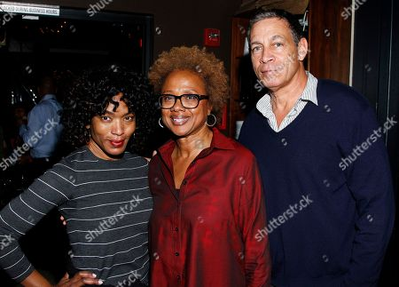 "Actress Angela Bassett (L) and Brad Johnson (R) seen with Paula Williams Madison who hosted industry friends at screening of her autobiographical documentary, ""Finding Samuel Lowe: From Harlem to China which traces her family's roots from Jamaica to China, on in Los Angeles, California"