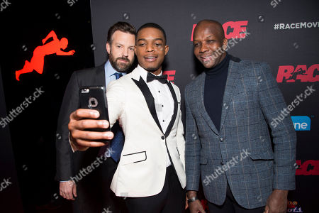 """Actors Jason Sudeikis and Stephan James and Olympian Donovan Bailey seen at the Focus Features premiere of """"Race"""", in Toronto"""