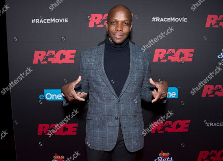 """Olympian Donovan Bailey seen at the Focus Features premiere of """"Race"""", in Toronto"""