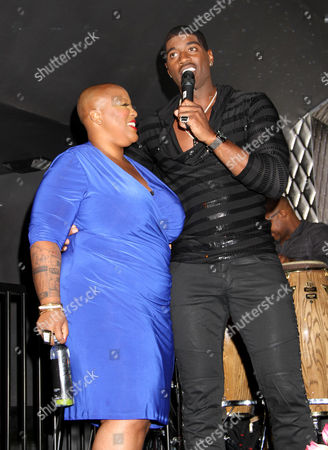 Frenchie Davis, left, and Terrell Carter perform at For the Love of R&B - A Tribute to Whitney Houston at Tru Hollywood, in Los Angeles