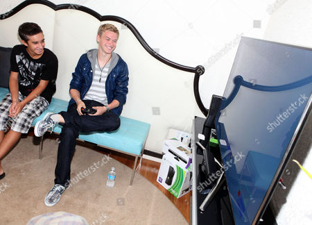Kenton Duty, right, and Georges Marini visit the Xbox 360 and Children's Miracle Network Gaming and Giving for Good (G3) Miracle Lounge on in West Hollywood, Calif