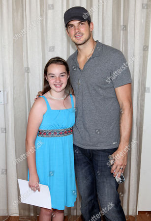 Rick Malambri, right, poses for a photo with CHLA patient Eileen Garrido, 13, at the Xbox 360 and Children's Miracle Network Gaming and Giving for Good (G3) Miracle Lounge on in West Hollywood, Calif