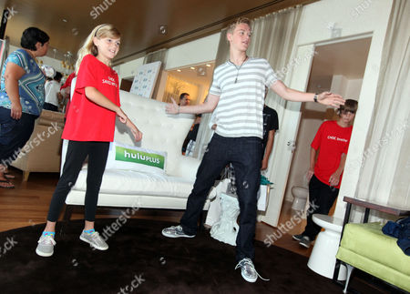 Kenton Duty, right, plays games with CHOC patient Katie Gerberding, 10, at the Xbox 360 and Children's Miracle Network Gaming and Giving for Good (G3) Miracle Lounge on in West Hollywood, Calif