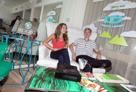 Kelli Berglund, left, and Kenton Duty visit the Xbox 360 and Children's Miracle Network Gaming and Giving for Good (G3) Miracle Lounge on in West Hollywood, Calif