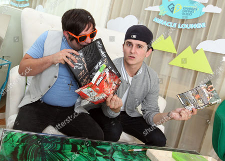Mitchel Musso, right, and Mason Musso visit the Xbox 360 and Children's Miracle Network Gaming and Giving for Good (G3) Miracle Lounge on in West Hollywood, Calif