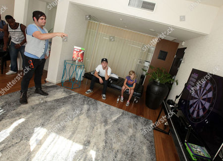 Stock Photo of Mason Musso, left, plays a game with Mitchel Musso, center, and CHOC patient Katie Gerberding, 10, at the Xbox 360 and Children's Miracle Network Gaming and Giving for Good (G3) Miracle Lounge on in West Hollywood, Calif