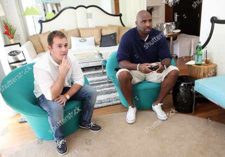 Ephraim Salaam, right, visits the Xbox 360 and Children's Miracle Network Gaming and Giving for Good (G3) Miracle Lounge on in West Hollywood, Calif