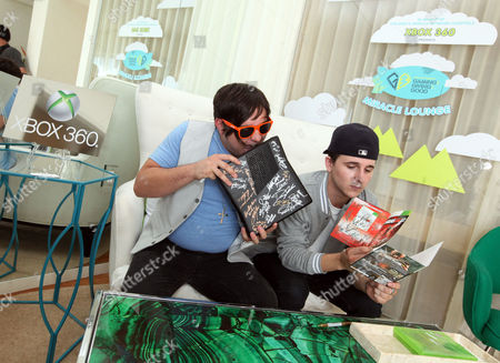 Stock Picture of Mitchel Musso, right, and Mason Musso visit the Xbox 360 and Children's Miracle Network Gaming and Giving for Good (G3) Miracle Lounge on in West Hollywood, Calif