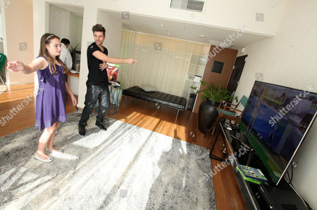 Ryan Good, right, an CHLA patient Eileen Garrido, 13, play a game at the Xbox 360 and Children's Miracle Network Gaming and Giving for Good (G3) Miracle Lounge on in West Hollywood, Calif