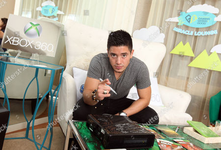 Stefano Langone signs an Xbox at the Xbox 360 and Children's Miracle Network Gaming and Giving for Good (G3) Miracle Lounge on in West Hollywood, Calif