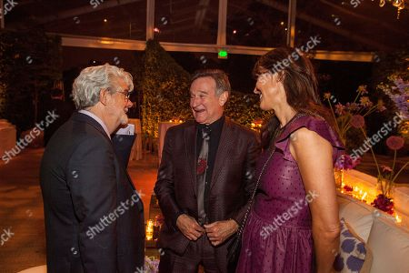 George Lucas, Robin Williams and wife Susan Schneider during the George Lucas and Mellody Hobson's wedding reception at Promontory Point on in Chicago