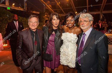 Robin Williams, Susan Schneider, Mellody Hobson and George Lucas during the George Lucas and Mellody Hobson's wedding reception at Promontory Point on in Chicago