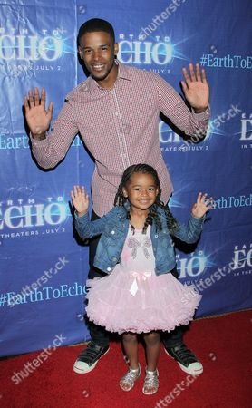 """Actor Gregg Wayans and daughter seen at Holly Robinson Peete's Screening of Relativity's """"Earth To Echo"""" Benefiting the HollyRod Foundation at Pacific Theatres at the Grove, in Los Angeles, California"""