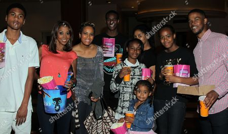 """Stock Image of From left: RJ Robinson Peete, Holly Robinson Peete, Daphne Wayans, Wayans children and Gregg Wayans (R) seen at Holly Robinson Peete's Screening of Relativity's """"Earth To Echo"""" Benefiting the HollyRod Foundation at Pacific Theatres at the Grove, in Los Angeles, California"""