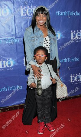 """Actress Paula Jai Parker and her son Onederful Vanglorious Jaxon N'Krumah Martin seen at Holly Robinson Peete's Screening of Relativity's """"Earth To Echo"""" Benefiting the HollyRod Foundation at Pacific Theatres at the Grove, in Los Angeles, California"""