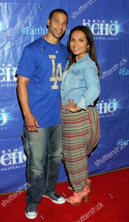"Aaron D. Spears and wife Estella Spears seen at Holly Robinson Peete's Screening of Relativity's ""Earth To Echo"" Benefiting the HollyRod Foundation at Pacific Theatres at the Grove, in Los Angeles, California"