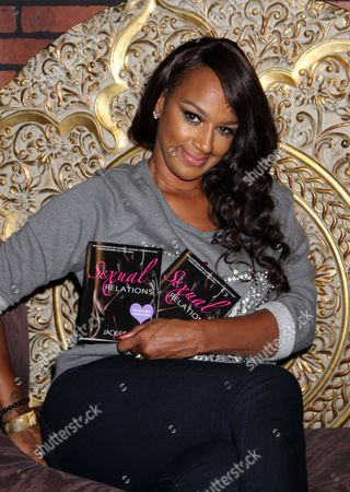 "Basketball Wives LA cast member and author Jackie Christie seen at her ""Sexual Relations: A His & Hers Guide to Greater Intimacy"" Book Launch as part of Basketball Wives LA season 3 at Sushi Kingz on in Hollywood, California"