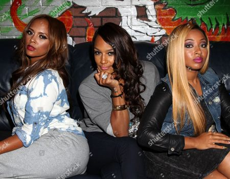 "Basketball Wives LA cast members (L-R) Sundy Carter, Jackie Christie and Brittish Williams pose backstage at Jackie Christie's ""Sexual Relations: A His & Hers Guide to Greater Intimacy"" Book Launch as part of Basketball Wives LA season 3 at Sushi Kingz on in Hollywood, California"