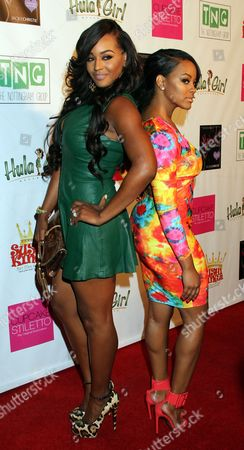 """Basketball Wives LA cast members Brandi Maxiell and Malaysia Pargo attend Jackie Christie's """"Sexual Relations: A His & Hers Guide to Greater Intimacy"""" Book Launch as part of Basketball Wives LA season 3 at Sushi Kingz on in Hollywood, California"""