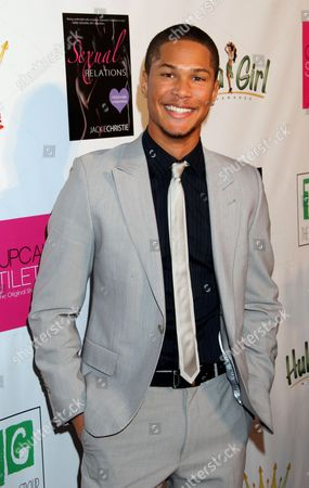 """Actor Najee De-Tiege attends Jackie Christie's """"Sexual Relations: A His & Hers Guide to Greater Intimacy"""" Book Launch as part of Basketball Wives LA season 3 at Sushi Kingz on in Hollywood, California"""