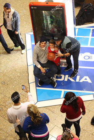 Chicago Bulls center Joakim Noah greets his fans with his new Nokia Lumia 920 at the Nokia Experience Center, during the Joakim Noah Nokia Mall Tour, on in Schaumburg, Ill