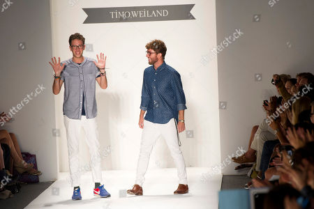 Designers Timo Weiland, right, and Alan Eckstein walk the runway at the Spring 2013 Timo Weiland runway show at Mercedes-Benz Fashion Week on in New York